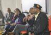platform at meeting man speaks into mic