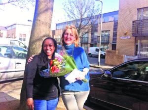 Sophia Ruck Home Start volunteer being presented with flowers