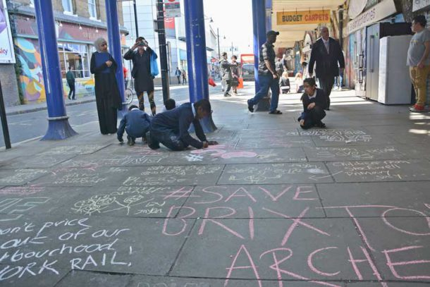 Pupils chalking pavement