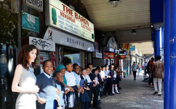 Lining up for a group photo with teacher Aine Milner from Stockwell Primary on the left