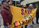 Library protesters outside a council meeting