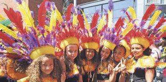 Sunshine Arts International children in carnival costume