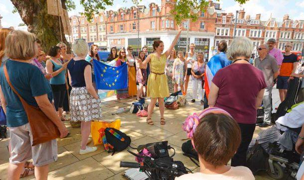 Xenia Davis leads the singing in Windrush Square