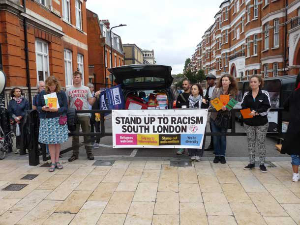 Stand Up to Racism banner at Calais collection on Windrush Square