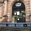 Library campaigners said school pupils had shown their support for the campaign by placing 'crime scene' tape around the dorr