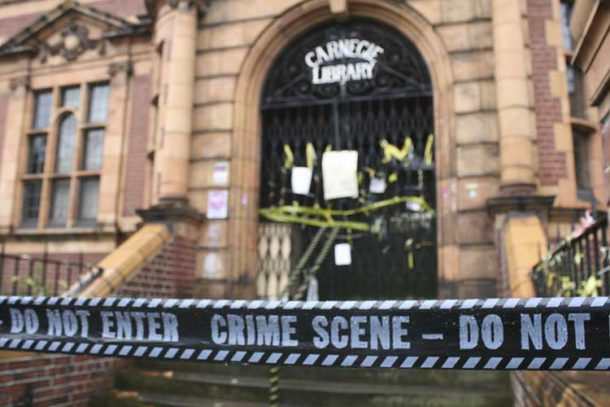 'Crime scene' tape around the door of the Carnegie library