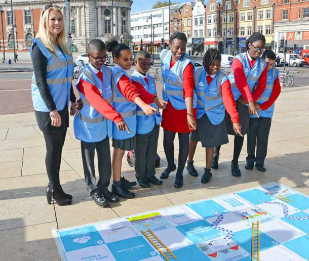 Cllr Brathwaite joins pupils to point out the dangers of engine idling