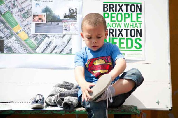 Child with Brixton Green poster Picture © Fiona Freund