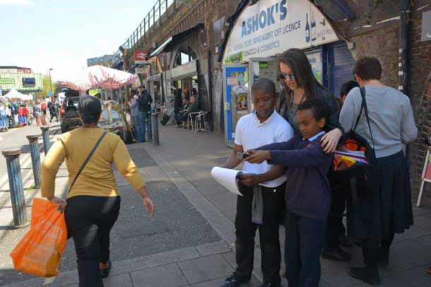 Stockwell primary school pupils in Brixton Station Road working on a project on the Network Rail arches