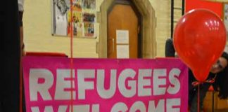Refugees welcome banner