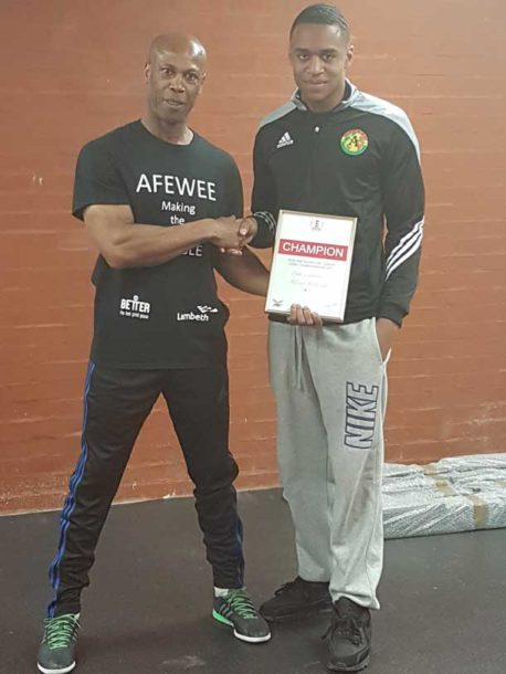 Afewee Founder Steadman Scott (pictured on the left) with Joel Joseph, a 15 year-old national amateur boxing champion.