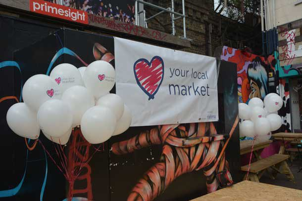 Love Your Local Market banner in the Village