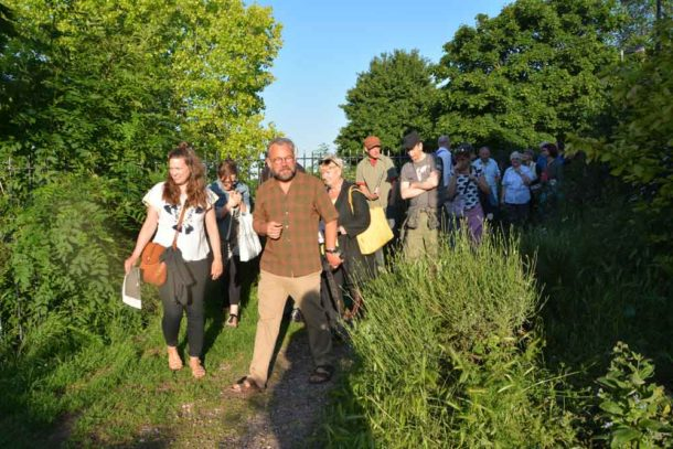 Mark leads the tour of his open-air exhibition