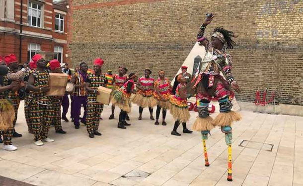 African stilt walkers were part of the celebrations