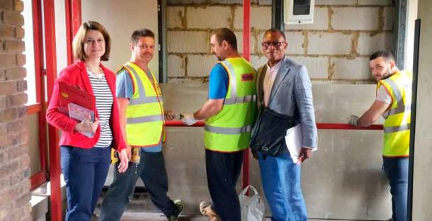 Local MP Helen Hayes and councillor Donatus Anyanwu with workers removing Barrier Block cladding