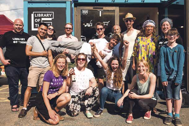 The Library of Things team outside the container