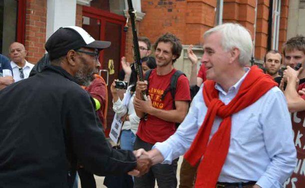 A supporter congratulates John McDonnell om his speech