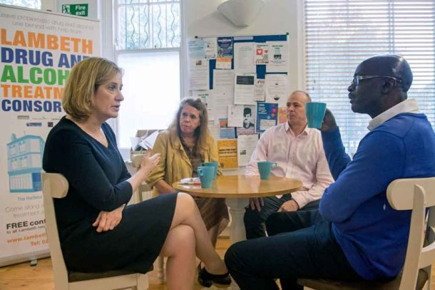 Home Secretary Amber Rudd talks to key worker Ken Davis (right), centre manager Dawn Brecken (second left), and key worker Junior Atkins, during her visit to the Harbour recovery centre in Brixton ahead of the launch of the government's new drug strategy