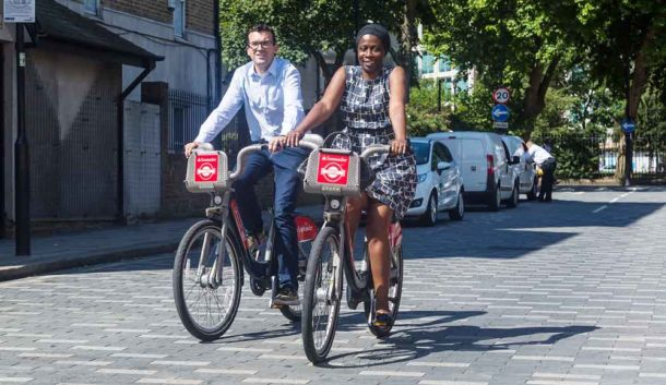 Jennifer Brathwaite and Will Norman, London Walking and Cycling Commissioner, try out the new bikes in Saltoun Road