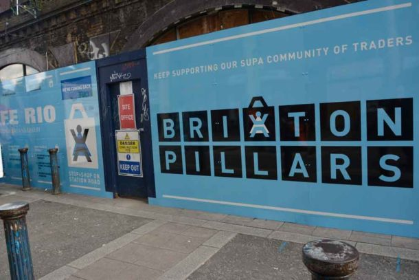 New hoardings on Brixton arches