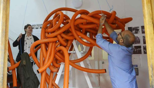 Julie and Ash of Variant Office get ready to hoist their giant sculpture into place at the Brixton Community Base