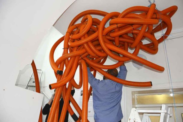 It's a bit of a struggle, but Ash and Julie get the sculpture secured to the ceiling