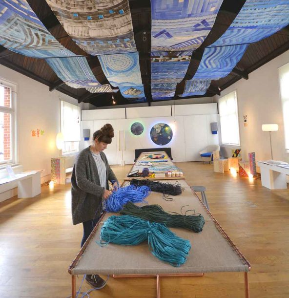 Zuzana prepares to work on Penelope's Dream with Gaya Giacometti's Tappeti Stellati above her seven-metre-long table