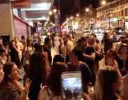 11pm. Mass singalong outside Brixton Tube station – yards from people's homes