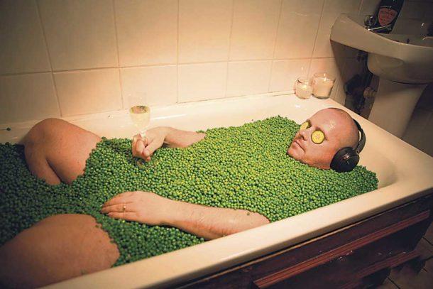 MasterChef runner-up Steve Kielty in a bath full of peas