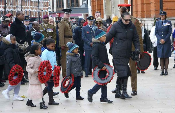Children prepare to lay wreaths at the African Caribbean war memorial in Brixton's Windrush Square