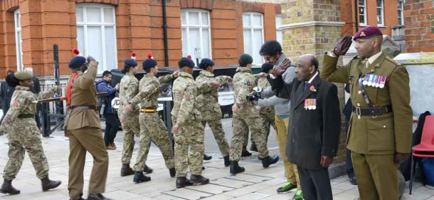RAF veteran Neil Flanigan, MBE, president of the West Indian Association of Service Personnel, and Lieutant Colonel Sulle Alhaji take the salute