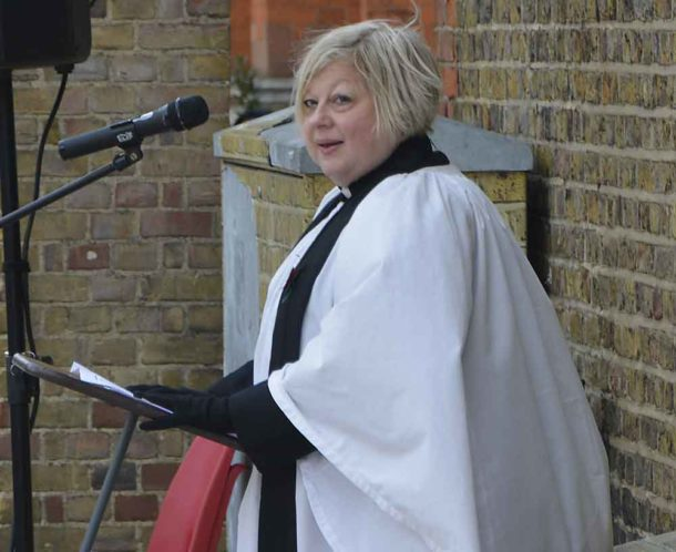 The Rev Erica Wooff of the Stockwell parish of St Andrew and St Michael reads the names of the countries whose people served in the British army in two world wars