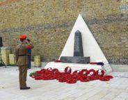 Saluting memorial and wreaths