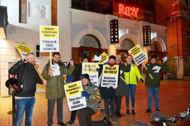 Supporters of the Ritzy strikers brave the cold to picket the cinema urging potential patrons to back the boycott