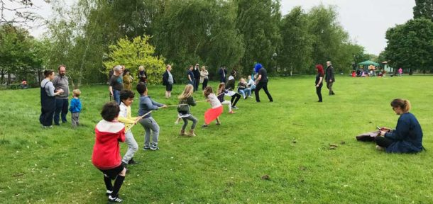 Children's tug of war at a Community Greenhouses event in Brockwell Park
