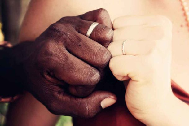 Couple show off their wedding rings