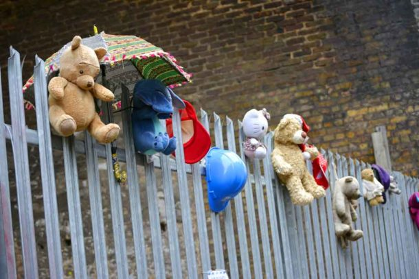 Stuffed toys on railings in Valentia Place