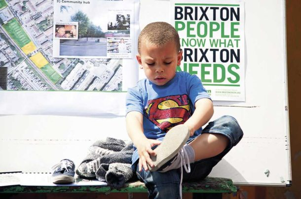 Child in Superman Costume at Brixton Green meeting