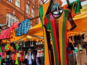 String vests on stalll in Brixton market
