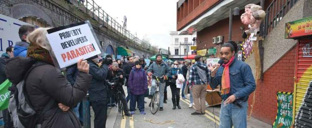 Local Green Party activist Rashid Nix addresses the protest