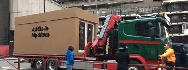 Giant shoebox on back of a lorry