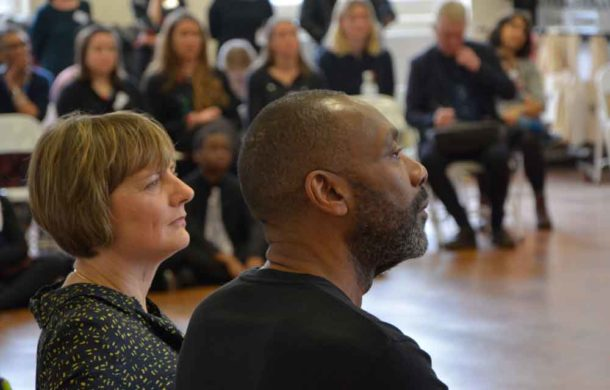 National Theatre executive director Lisa Burger and Sir Lenny listen to Becky Lawrence explaining the importance of the scheme