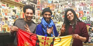 Gnawa players with flag