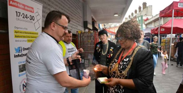 Nick Maxwell and Carol 'Lady Bling' look on as Lambeth mayor Marcia Cameron lights a lantern held by 17-24-30 founder Mark Healey