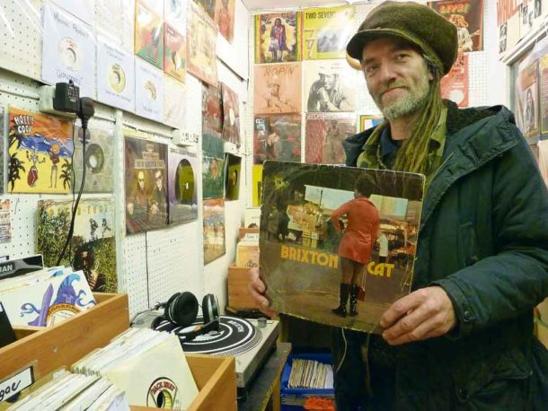 Markie Lyrics of Universal Roots Records with a rare copy of Joe Mansano's Brixton Cat