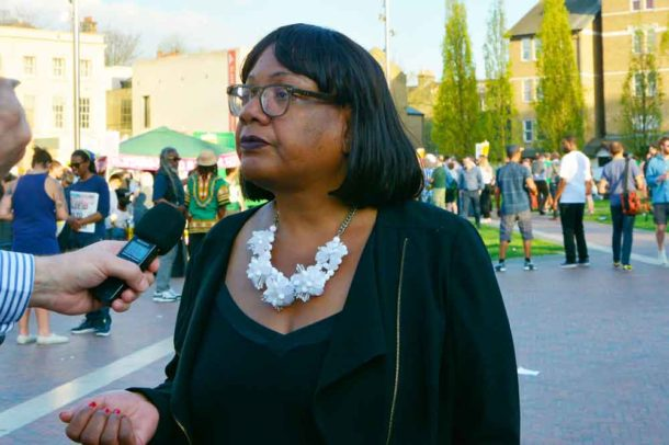 Diane Abbott answers reporters' questions in Windrush Square