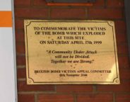 The plaque marking the bombing is today usually behind a row of trolleys