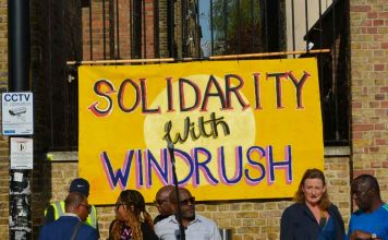 Windrush solidarity banner