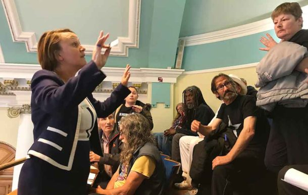 A Lambeth council official tells the protesters that Shirley Oaks compensation is not on the agenda for the meeting