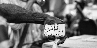 Hand with dominoes